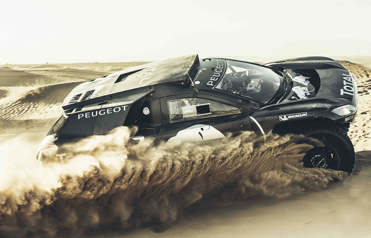 Carlos Sainz performs during the Peugeot test in Erfoud, Morocco, on September 15th, 2015
